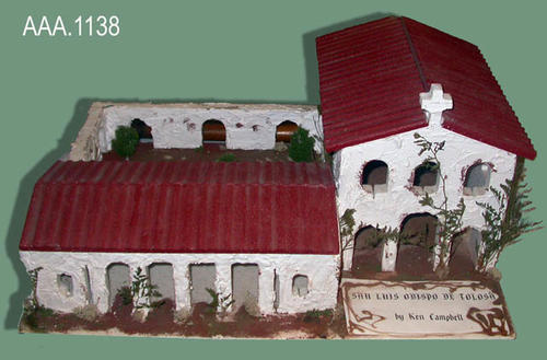 "This artifact is a student's model of the Mission San Luis Obispo.  This model measures 23 1/2"" in width, 18"" in depth and is 11"" tall at its ighest point."