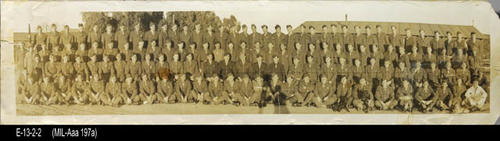 "This is a B/W group photo of men in uniform. The uniform insignia on the shoulder identifies the soldiers as being part of the Western Defense Command that was active during WWII. After WWII it was demobilized. - MEASUREMENTS:  Photo:  8"" x 31 3/4"""" - CONDITION:  Good. Top right and bottom corner torn off in the margin area. Creases and taped tears are also visible. - Photograph is kept in a protective sleeve. - COPIES:  1."