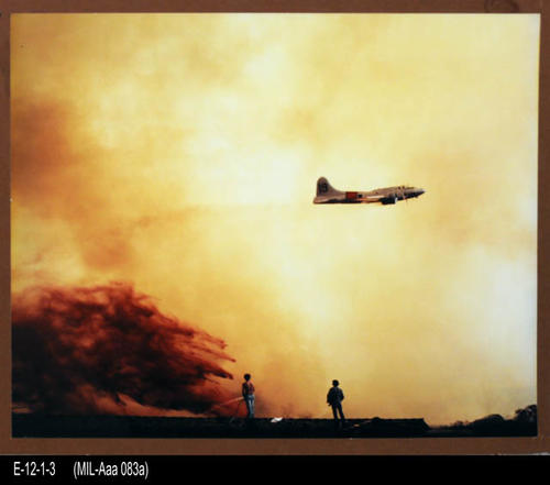 "This is a color photograph of an air drop being made in conjunction with a 1977 fire. - MEASUREMENTS:  Photo:  Unmounted: 16"" x 19 - Mounted: 17 1/4"" x 20 3/4"" - CONDITION:  Excellent - COPIES:  1."