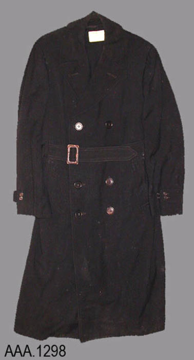 "This artifact is a Navy overcoat with coat liner.  It is a size:  Long 38 and is black in color.  It was worn by Ens. Ted J. Todd.  The label on the inside of the coat reads as follows:  ""THIS LABEL IDENTIFIES A GARMET MADE and SOLD UNDER AUTHORITY OF THE U.S. NAVY -  Navel Insignia logo - Regulation U. S. Navy Uniform.""  A homemade label made from tape reads:  ""T. J. Todd - 1039 E. Grand Blvd. - Corona, Calif.""  The coat liner label reads:   ""Clothcraft Clothes - Tailored by _ The Joseph and Feiss Co. - Size:  Long 38 - T. J. Todd.""  CONDITION:  The leather on the belt buckle is beginning to deterioriate."