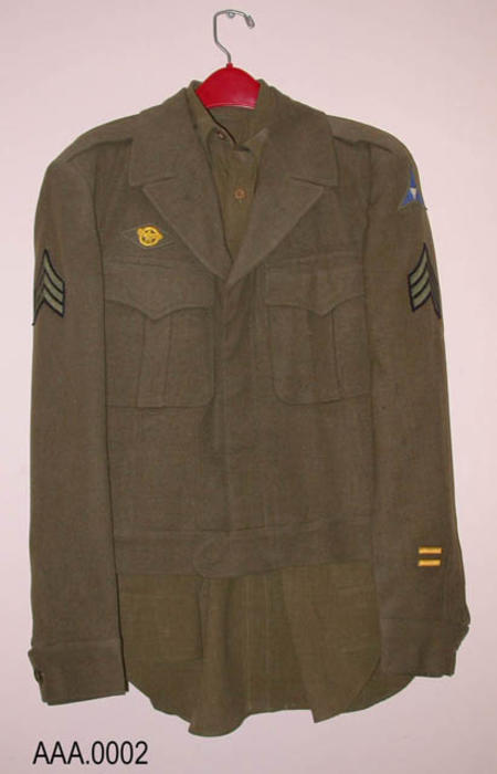 This artifact is a WWII U.S. Army uniform - wool - Shirt with Sgt. stripes - trousers - tie- Eisenhower jacket with Sgt stripes.  CONDITION: good - some moth holes in jacket.