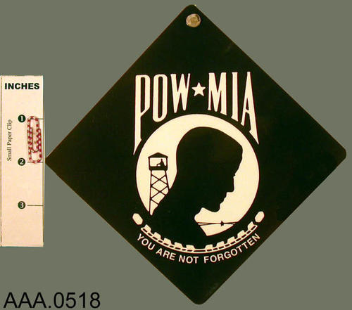 "This artifact is a black POW - MIA sign with white letters that read:  "" POW * MIA - You are not forgotten."""