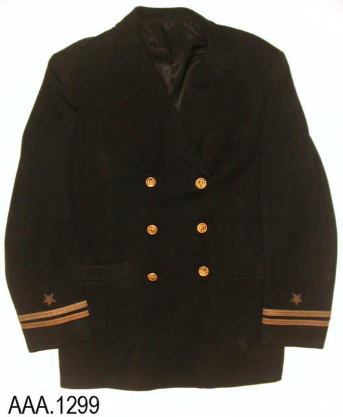 "This artifact is a U. S. Navy, double breasted, uniform jacket, with brass buttons worn by Ens. Ted J. Todd.  The jacket measures 32"" from the collar to the hem of the jacket and 19"" from shoulder seam to shoulder seam.  The coat label reads:  ""Julius Horowitt - Tailor to Gentlemen - Brooklyn, New York; Long Beach, California; San Diego, California.""  The inside vest pocket label reads:  ""Ens. J. T. Todd - 55-1-43 - UCLA."""