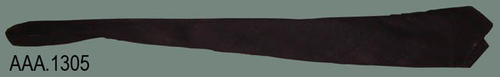 "This artifact is a black uniform necktie.  It measures 48 1/2"" in length."