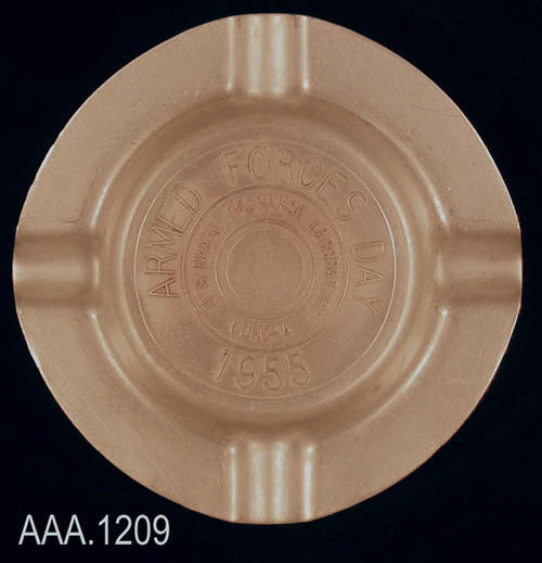 "This artifact is a circular, aluminum ash tray.  The text on the artifact reads: ""Armed Forces Day 1955 - U. S. Naval Ordnance Laboratory  - Corona.""  The artifact measures 4 1/8"" in diameter."