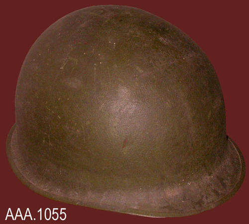 "This artifact is an army helmet owned by Police Chief Joe Greer.  It was used by Chief Greer during World War II for protection from bullets and other dangers.  The helmet is made of steel and has a cloth strap.  It is khaki green in color and measures 11"" x 9"" x 7"".  The rim diameter is 32"" DONOR'S REMARKS:  This helmet was given by Judy Greer, the widow of Chief Joe Greer."