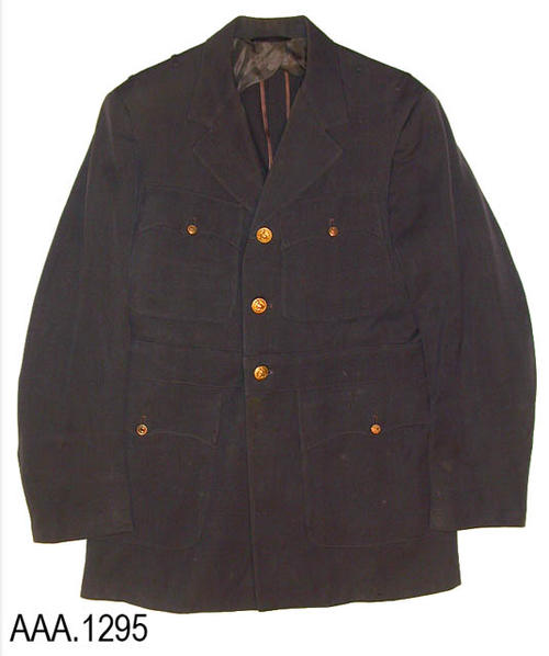 "This artifact is a medium gray, U. S. Navy, uniform jacket worn by Theodore Jameson Todd.  The jacket measures 33"" in length and 18"" from shoulder seam to shoulder seam.  The outside label on the inside vest pocket reads:  ""Ship's Service Store - Naval Air Station - Norfold, VA.""  The label on the inside of this vest pocket reads:  ""Better Class Tailoring - VA 327 - Mr. T. J. Todd - 9-23-43.""  CONDITION:  There is some spotting of the coat."