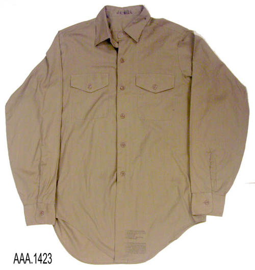 This artifact is a man's, full sleeve, khaki, size 14 !/2 shirt.   This shirt is part of the Chris Harvey Eagle Scout Project:  Heroes Of Our Community - Corona, California - 2007.   CONDITION:  The shirt is is very good condition with the exception of small, dark, spot on the collar and shirt back.