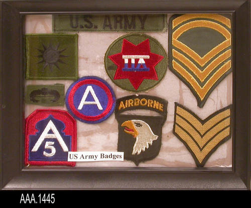 "This artifact is a framed collection of nine uniform patches from the U. S. Army.  This patch collection is part of the Chris Harvey Eagle Scout Project:  Heroes Of Our Community - Corona, California - 2007.   MEASUREMENTS:  9 1/2"" x 11 3/8"".  - CONDITION:  Very good."