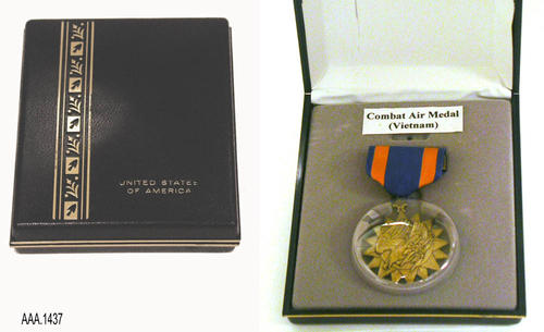 "This artifact is a Combat Air Medal (Vietnam) in a case.  The case is black with a gold graphic and text reading:  ""United States of America.""  The medal is a 16 point, bronze star with an eagle.  The ribbon is dark blue with two small vertical stripes. This medal and case are part of the Chris Harvey Eagle Scout Project:  Heroes Of Our Community - Corona, California - 2007. CONDITION:  Very good."