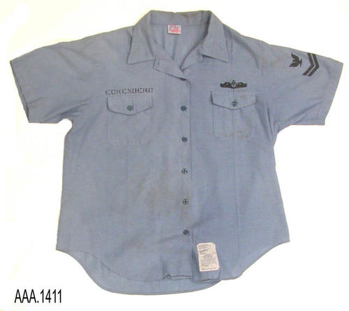 This artifact is a woman's, short sleeve, blue navy shirt, and is part of the Chris Harvey Eagle Scout Project:  Heroes Of Our Community - Corona, California - 2007.  CONDITION:  There is some very light, brown staining on the left side of the shirt, when viewing the picture, that is below the pocket.