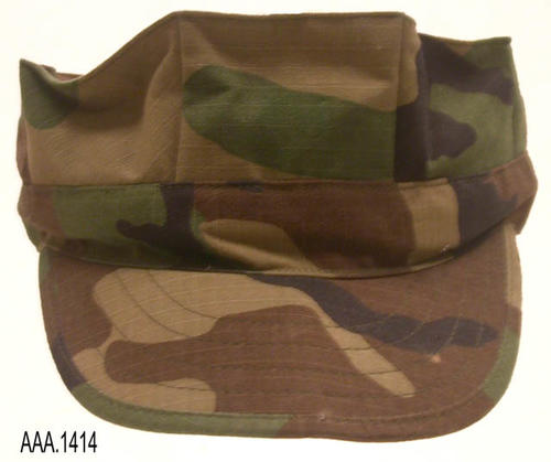 This artifact is a military cap made from material having a camouflage pattern, and is part of the Chris Harvey Eagle Scout Project:  Heroes Of Our Community - Corona, California - 2007.   CONDITION:  Like new.