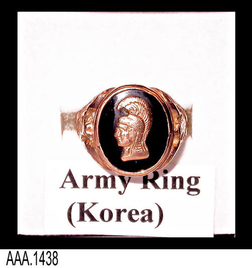 "This artifact is a 10K gold army ring (Korea) has a gold profile of an ancient warrior on onyx.  The ring comes in a black box with gold text reading:  ""Fine Jewelry."" This ring and box are part of the Chris Harvey Eagle Scout Project:  Heroes Of Our Community - Corona, California - 2007.   MEASUREMENTS:  Ring diameter is 3/4"".  The black holding box is 1 3/4"" x 1 5/8"" - CONDITION:  Very good."