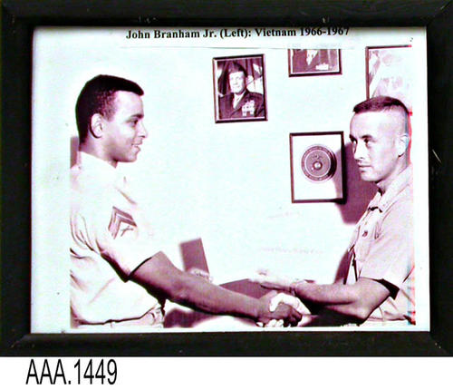 "This artifact is a framed picture of John Branham, Jr.:  Vietname War 1966-1967.  This framed picture is part of the Chris Harvey Eagle Scout Project:  Heroes Of Our Community - Corona, California - 2007.   MEASUREMENTS:  9 1/2"" x 12"".  - CONDITION:  Very good."