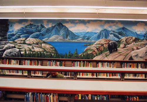 "Photograph of the Sierra Nevada Mountain mural in the Library's Children's Room. It is another of the California ""environments,"" each mural authentically depicting the flora, fauna, and wildlife of the area, thereby providing an accurate learning experience for students and adults. The mural was designed and painted by Sean and Patrick Johnson."