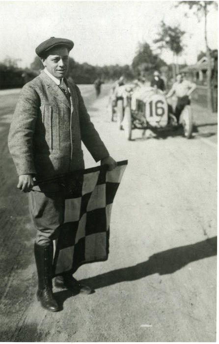 Paul Wagner - The starter for the Corona Road Race. He is standing at the start/finish line paint.  The building for the officials is where Hattan's Market is presently., New