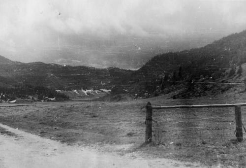 Photograph of an airstrip created by Phil Newhouse and the Italian Partisans during World War II. Phil Newhouse was taken in by the Italian after his B-25 was downed over northern Italy. He worked with the Partisans to create an airstrip and airdrop location used by the British military during the war. The photograph was taken by an English RAF Captain who tracked down Mr. Newhouse after the war and mailed him copies of the photos he'd taken of the group., This is a digital image, the original was returned to the donor after scanning.