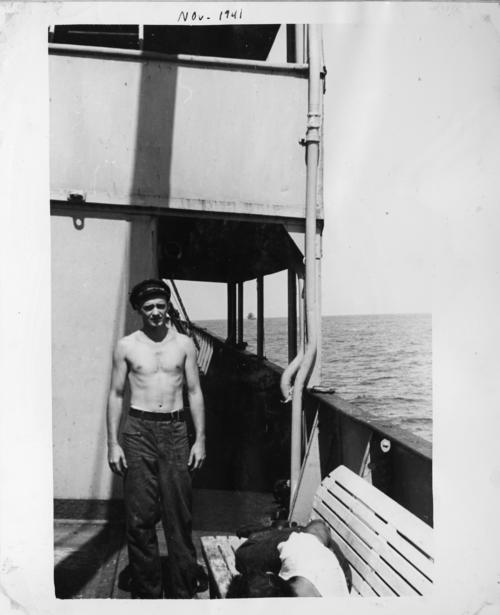 Photograph of a crew member on the USS Omaha. The image was part of Abner Lonnie Alton's personal collection of World War II photographs. Alton served on the Omaha during the war., This is a digital image, the original was returned to the donor after scanning.