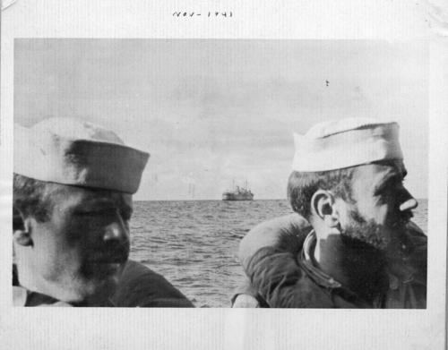 Photograph of crew members in a lifeboat with the <em>Odenwald</em> in the background. The image was part of Abner Lonnie Alton's personal collection of World War II photographs. Alton served on the <em>USS Omaha</em> during the war., This is a digital image, the original was returned to the donor after scanning.