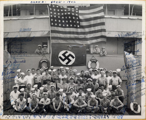 Photograph of the <em>USS Omaha</em> crew on the captured Nazi ship, <em>Odenwald</em>.  The <em>Odenwald</em> was flying the US flag and had identified itself as the <em>Willmoto</em> out of Philadelphia. The crew attempted to scuttle the ship when the Omaha approached. The Omaha crew saved the ship and found the Nazi flag and <em>Odenwald</em> life preserver on board. Crew members pictured here signed their names on photograph. Abner Alton served on the Omaha before and during World War II., This is a digital image, the original was returned to the donor after scanning.