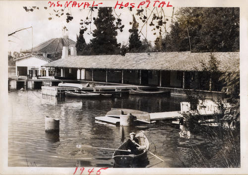 Photograph of a sailor rowing a boat on Lake Norconian at the U.S. Naval Hospital. The Lake Norconian Club was originally opened in 1928 and was a resort for the wealthy and Hollywood elite. During the Great Depression the resort shutdown. The U.S. Navy purchased the facility and land just before the attack on Pearl Harbor in 1941. The facility was converted into a hospital to treat the ill and wounded U.S. Armed Forces., This is a digital image, the original was returned to the donor after scanning.