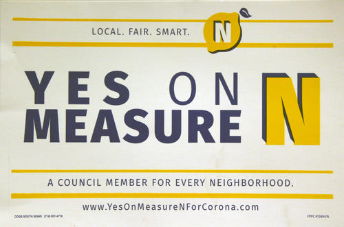 "Poster for the citizen campaign to pass Measure N in Corona on November 8, 2016. The measure created five neighborhood based Council districts. Beginning in 2018 Districts 1, 4, and 5. Then in 2020 Districts 2 and 3. There will one Council member elected from and by each district. This system replaced the citywide or ""at large"" City Council election process."