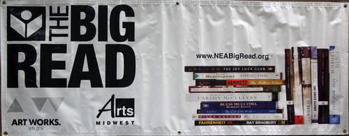 "A banner used to promote the Library's participation in The Big Read. ""An initiative of the National Endowment for the Arts in partnership with Arts Midwest, the NEA Big Read broadens our understanding of our world, our communities, and ourselves through the joy of sharing a good book. Showcasing a diverse range of contemporary titles that reflect many different voices and perspectives, the NEA Big Read aims to inspire conversation and discovery."" (NEA Big Read, <a href=""https://www.arts.gov/partnerships/nea-big-read/about-nea-big-read"">https://www.arts.gov/partnerships/nea-big-read/about-nea-big-read</a>) The Library selected Ray Bradbury's <em>Fahrenheit 451</em> for the 2014 program."