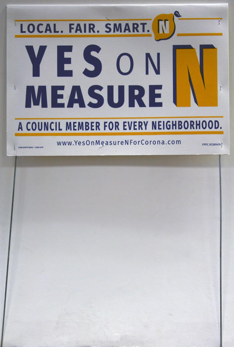 "Yard sign for the citizen campaign to pass Measure N in Corona on November 8, 2016. The measure created five neighborhood based Council districts. Beginning in 2018 Districts 1, 4, and 5. Then in 2020 Districts 2 and 3. There will one Council member elected from and by each district. This system replaced the citywide or ""at large"" City Council election process. The sign is double-sided, same text is printed on both sides."