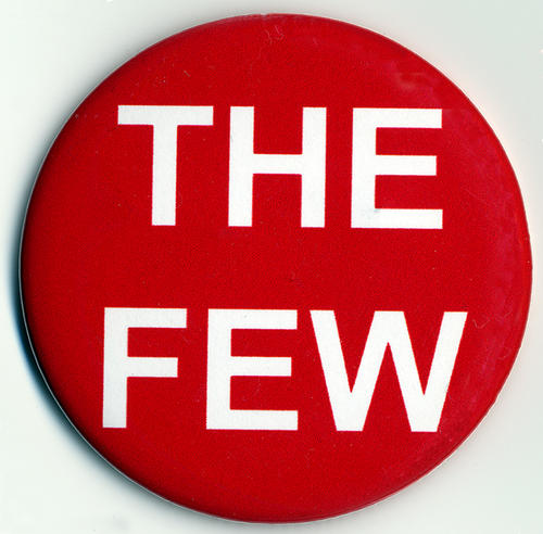 "A red button pin with white text ""THE FEW"". The button was a citizen campaign to pass Measure N in Corona on November 8, 2016. The measure created five neighborhood based Council districts. Beginning in 2018 Districts 1, 4, and 5. Then in 2020 Districts 2 and 3. There will one Council member elected from and by each district. This system replaced the citywide or ""at large"" City Council election process. There is a small 1"" strip of rust on the back of the button."
