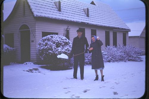 "This photo was taken in the front yard of 1104 South Vicentia in January, 1949 when Southern California experienced snowfall from January 9th through January 12th. This photo is courtesy of Robert ""Ed"" Munn, who as a young boy of 14, took photos of Corona in the late 1940's. Photography was one of his hobbies. Ed Munn was the son of Dr. & Mrs. William B. Munn DDS and his family lived on West 11th St in Corona from 1938 to 1959., The description is from the donor's note on the back of the photograph."
