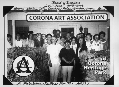 Photograph of the Corona Art Association's Board of Directors 2001-2002, 2002-2003. The first names of some of the Directors are written on the photograph: Diane, Shirley, Caty, Carolyn, Helen, Sandra, Mary, and Ben. The photo was taken at Corona Heritage Park when the association resided at that location.