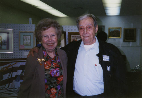 Photograph of Maxine Piester and Dominick Frascella at Mr. Frascella's 2001 art show. Both Ms. Piester and Mr. Frascella were founding members of the Corona Art Association.