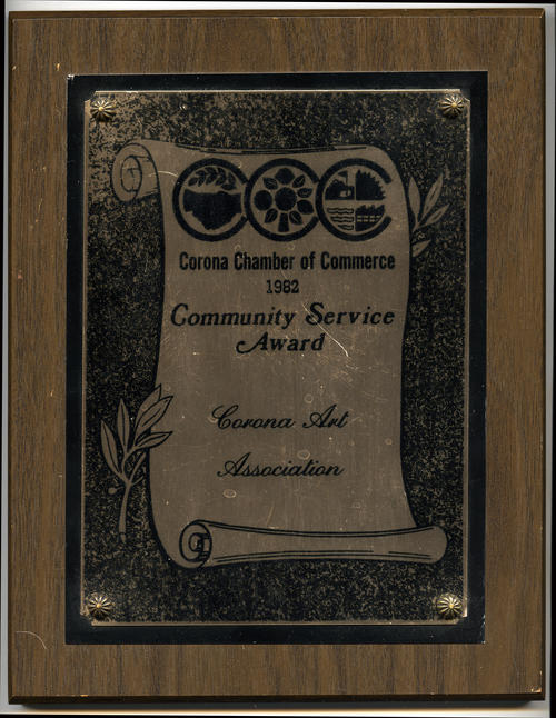 Photograph of a Community Service Award plaque given to the Corona Art Association by the Corona Chamber of Commerce in 1982.
