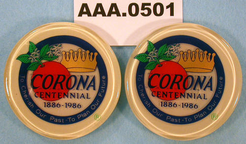 "Two circular magnets with the City Seal and ""Centennial 1886-1986"" printed on it."