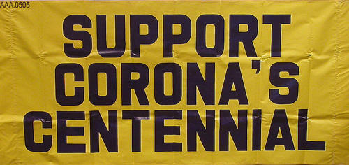 "Banner with the phrase ""Support Corona's Centennail."""