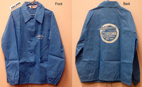 "Light blue windbreaker, size extra large, with ""Corona Centennial 1886-1986"" and the City Seal printed on it."