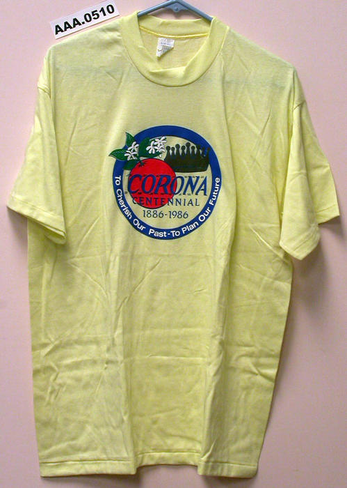 "Yellow T-shirt, size extra large, with large City Seal and ""Corona Centennial, 1886-1986"" printed on the front."