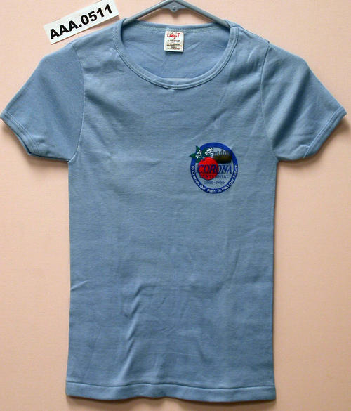 "Woman's light blue T-shirt, size small, with City Seal and ""Corona Centennial 1886-1986"" printed on the left breast."