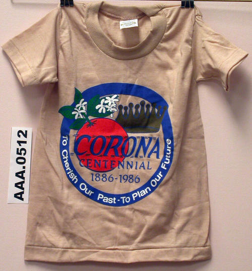 "Light brown T-shirt (children's size 4), with City Seal and ""Corona Centennial 1886-1986"" on the front."