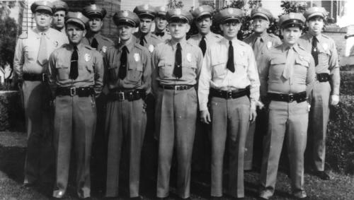 Back row, left to right: Chief Joe Lowery, Desk Sgt. W.E. Heckert, Officer R.K. Wade, Officer A.D. Ensley, Traffic Officer J.W. Greer, Lt. L.S. Charlesworth, Capt. C. J. Lincoln, Sgt. R.C. Royce.