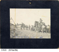 Photo - 1908 - Men posed with thrasher in field.