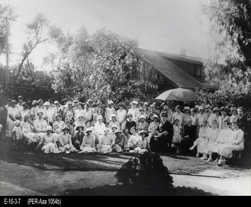 "This is a black & white photograph of 72 women from the Woman's Improvement Club in Corona.  The group is on the lawn.  - Photo: 11"" x 14"" - CONDITION:  Very good - This photograph is a recent black & white photograph of the original. (SEE: CLU-Wom 001b / E-14-2-6)  Photograph is kept in a protective sleeve. - COPIES:  1."