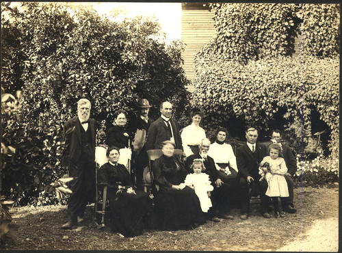 SEATED: Deanna Stobbs, Hannah and John Stobbs, Mattie Fink, sister of Ed Stobbs, and wife of Luther Fink; Children: Bernice and Leone Fink.  STANDING: Matt Stobbs, Irving Cohen and wife(?), Matt and John Stobbs were brothers.  They all came to Corona about 1902 or 3. The Finks had a grove in Garrettson about where the school is. Cohen had a grove near Ontario and Buena Vista (?) John Stobbs ha a grove above Olive on Vicentia or Taylor on the west side of the street.