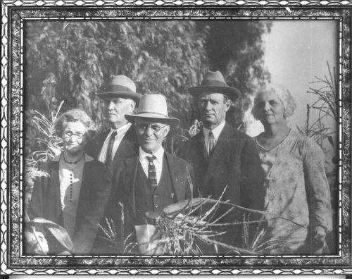 Left to Right: Mary Stobbs McNeil, Ed Stobbs, Cary D. McNeil and Luther and Mattie Fink in a cornfield.