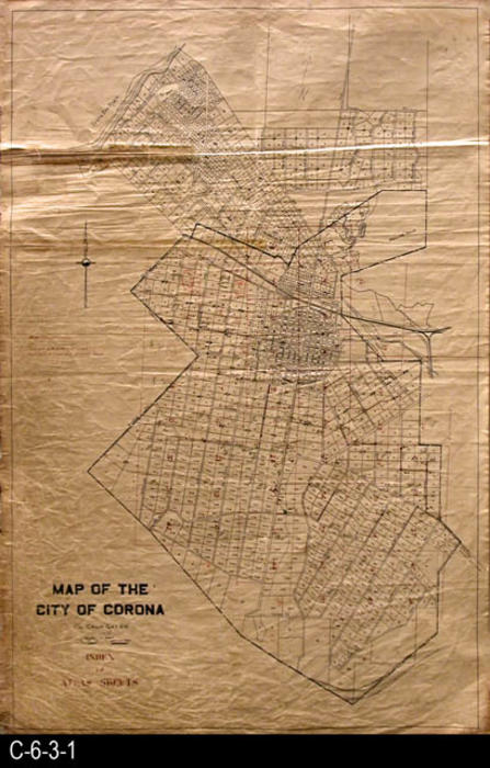 "ThIs oil skin, Corona map shows the parcel numbers for property.  Red text indicates that this map is an index for atlas sheets.  Parcel numbers are in blue, while index numbers are shown in red.  - MEASUREMENTS:  36"" X 23.5"" - CONDITION:  This map shows substantial wear and tear.  There are three taped sections in the upper left area of the map. - COPIES:  1 - MAP ORIENTATION:  Top is NORTH."