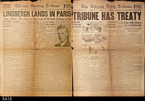 "NEWSPAPER:  This double sided front page is part of the facimile collection of sixteen historic front pages that the Chicago gave in 1933 to its readers.  May 1927 side highlights Lindbergh solo flight and landing in Paris. June 1919 side discusses the terms of the WWI Peace Treaty.  - PAGES:  2 - MEASUREMENTS:  23 1/2"" x 17 1/2"" - CONDITION:  This newspaper is deteriorating.  Fold lines are darker in color and several holes can be seen.  - COPIES:  1."