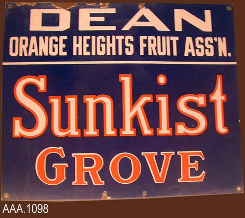 "This artifact is a metal sign measuring 15"" in length and 18"" in width.  The white and red letters are on a navy blue background.  The sign reads:  ""Dean - Orange Heights Fruit Ass'n. - Sunkist - Growers.""  CONDITION:  There is evidence of rust at the top and bottom of the sign."