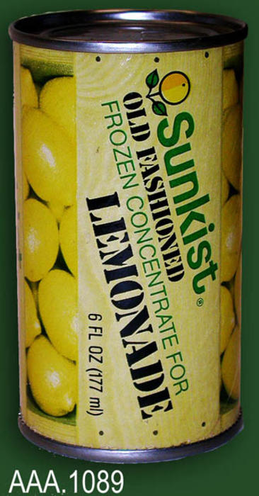 "This artifact is a juice can.  The label reads: ""Sunkist - Old Fashioned Lemonade - Frozen Concentrate for - Lemonade.  6 FL OZ (177 ml)."""