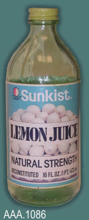 This artifact is a glass bottle.  The label reads as follows:  Sunkist Lemon Juice - Natural Strength - Reconstituted - 16 Fl. Oz. (1 pt.) 437 ml.