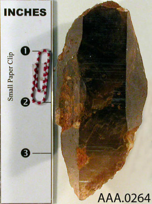 This artifact is a large, six-sided smoky quartz. Donor's Remarks:  This artifact was found at Cajalco and Temescal Roads, El Cerrito.